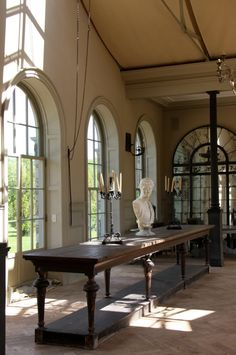 Wall of Palladian windows with French doors....Tendenze Design.  I always love Palladian architecture!