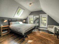 26 Rustic Bedroom Design and Decor Ideas for a Cozy and Comfy Space - The Trending House Attic Master Bedroom, Attic Bedroom Designs, Rustic Bedroom Design, Upstairs Bedroom, Bedroom Loft, Slanted Ceiling Bedroom, Slanted Walls, Attic Bedroom Ideas Angled Ceilings, Sloped Ceiling