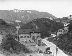 "Homes started to punctuate the Hollywood hills after the ""Hollywoodland"" development kickstarted things (but largely failed, at least initially) in 1924. Description from pinterest.com. I searched for this on bing.com/images"