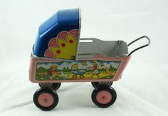 I have this adorable vintageTIN BABY CARRIAGE in my personal collection-sweet!