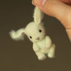 Needle Felted Mini Bunny by Kamila. (I wish she wasn't holding him by the ear, looks painful! )