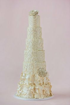 Elegant Modern Vintage wedding cake-- love how this looks like a vintage wedding dress. Ivory icing -- bottom layers w fondant rose petals , middle layers-- looks like back of dress with beading down middle and fondant flowers attached to look like lace Pretty Wedding Cakes, Elegant Wedding Cakes, Wedding Cake Designs, Trendy Wedding, Elegant Cakes, Diy Wedding, Wedding Stuff, Lace Wedding, Wedding Dresses