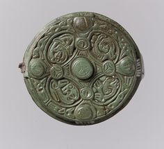 Round Box Brooch Date: 700–900 Geography: Made in Gotland, Sweden Culture: Viking Medium: Copper alloy, cast, traces of an iron pin Dimensions: Overall: 2 1/16 x 7/8 x 1/16 in. (5.2 x 2.3 x 0.2 cm)