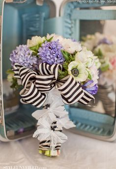 LOVE this vintage bouquet with the black and white striped bow!