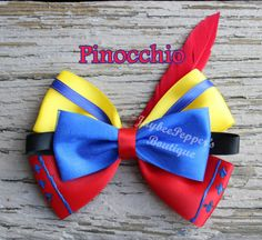 Arco de pelo Pinocho Pinocchio inspired hair bow from Hercules. Measures about across All bows are made in a smoke free environment and the ends of the bows are heat Disney Hair Bows, Diy Disney Ears, Disney Diy, Disney Crafts, Ribbon Art, Ribbon Bows, Ribbons, Boutique Hair Bows, Diy Hair Accessories