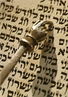 Reading from the Torah, written by hand by a scribe, one uses a pointer not one's finger to follow the text.