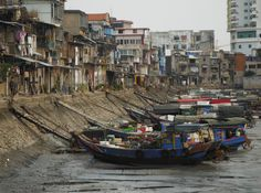 Fishing boats stuck in the mud at low tide in Xiamen, China.