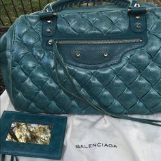 """Authentic Balenciaga Matelasse Rare Turquoise The smooth leather parts of the bag on the bottom of sides are """"crinkly""""....very soft.  The leather is goatskin.  The hardware is technically brass with a silver tone finish.  The corners are not worn.  The lining is pristine.  It comes with its dustbag,  and extra tassel leather mirror.  The bag measures 12"""" across, is 9 1/2"""" tall and is 5 1/2"""" deep. Balenciaga Bags Satchels"""