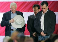 3/22 Ted S. Warren / AP file  Republican presidential candidate, former Massachusetts Gov. Mitt Romney, right, bows his head in prayer as he stands on stage with local elected officials including Elko County Commissioner Demar Dahl, left, during a campaign rally on Feb. 3 in Elko, Nev.