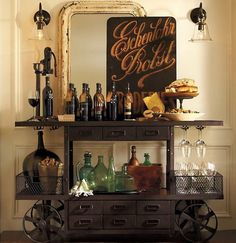 You can turn your bar cart into a mini-speakeasy with vintage bottles and art. | 19 Industrial Bar Carts That Will Up Your Drinking Game