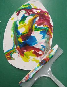 shaving ceam -mix in drops of color with fork-lay paper on it....use squeegee to scrape off shaving cream.