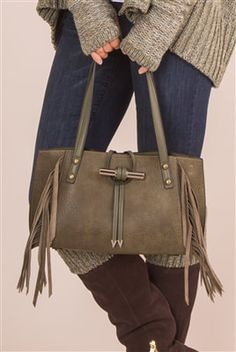 Simply Noelle Forever Fringe Small Crossbody Bag. 100% vegan leather. Leather-look finish with fringe. Toggle closure. Colors available: Black, sage, slate, java, taupe, or harvest. HB211  $69.99.