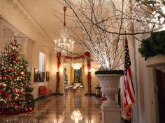 Oversized urns with crystal-lit branches decorate the Cross Hall. — Image courtesy of Washington, D.C., photographer Marty Katz