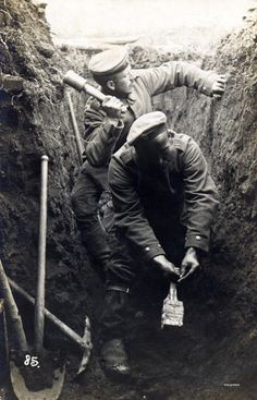 """Soldiers prepare to lob """"potato masher"""" grenades from their trench during WWI."""