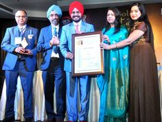 Delhi Bureau chief of Daily Excelsior HS Paul being awarded in New Delhi.