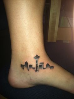 Seattle skyline. Done by Sean Lanusse at Infinity Tattoo in Portland, OR.