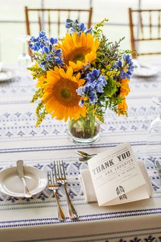 Blue and yellow wedding flower centerpieces with sunflowers. These are simpe and eye-catching at the same time. Photo: Joshua Zuckerman Photography // Featured: The Knot Arrangement Sunflower Centerpieces, Blue Centerpieces, Wedding Centerpieces, Wedding Decorations, Centerpiece Flowers, Centrepieces, Table Decorations, Yellow Wedding Flowers, Flower Bouquet Wedding