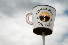 Driving east on Slauson Avenue, a giant coffee mug in the sky comes into view in the distance. The cup is the beacon for the newest location of Tierra Mia Coffee in Pico Rivera.