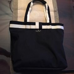 Kate Spade ♠️ Barrow Street Bon Shopper  Adorable Kate Spade Barrow Street Bon Shopper, in black and white, with bow detail  Very functional everyday bag with zip top. Authentic. Used but in great condition. kate spade Bags
