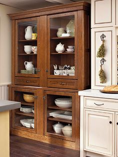 Once again, it goes to show you that if you like something, you can make it work! This china hutch was made from ordinary kitchen cabinetry. If you look closely, you can also see the beaded board wainscoting to the left of the hutch which contributes to the cozy and inviting feel of this kitchen space. BHG