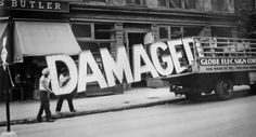 """Walker Evans's series """"Truck and Sign, 1928-1930."""" A battle could make damages, but also words and images are able to do so."""