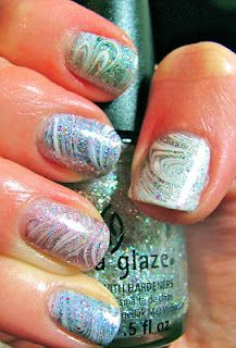 That is some SERIOUS glitter water marbling nail art...