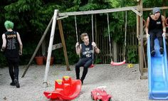Luke Hemming, Micheal Clifford, and Calum Hood from 5sos playing on a play ground. So cute!