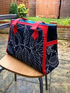 """The Park West Bag - I think this one might be it! Finished size says 18""""x13"""" (doesn't say how wide it is at the base), which should be plenty big enough for a file box and supplies. There are pockets on the outside for phone/keys. I'd like to add a couple of pen slots and maybe a small pocket for my post-its so those aren't rolling around all the time."""