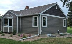 LP ®SmartSide® lap siding pre-finished with Terra Bronze, shakes in Coffee and trim in White.