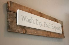 Truth be told on this laundry room sign!!  She found some old boards in her back yard, printed a font she liked (found online) copied it on with transfer paper and painted it to match her walls.  Found on:  http://granddesignco.blogspot.com/