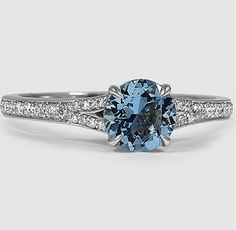 This White Gold Saphire Duet Diamond Ring is set with a gorgeous round aquamarine.