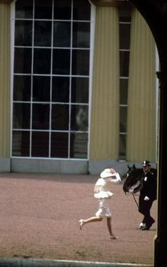 1987-06-13 Diana runs in the inner courtyard of Buckingham Palace to avoid being late for the Trooping The Colour ceremony
