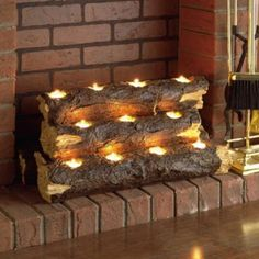 Southern Enterprise Burning Log Fireplace Candelabra - Re-create the rustic charm of a wood fire with the clever Southern Enterprise Burning Log Fireplace Candelabra . This handcrafted resin sculpture resembles. Fireplace Candelabra, Fireplace Lighting, Fireplace Ideas, Fireplace Filler, Fireplace Decorations, Decorating Ideas For Fireplace, Fall Fireplace Decor, Fireplace Design, Unused Fireplace