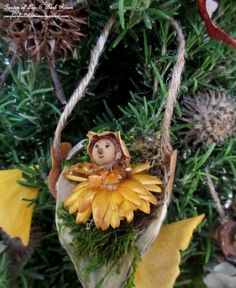 DIY ~ Baby Fairy in a Milkweed Pod Swing http://ourfairfieldhomeandgarden.com/diy-a-fairy-merry-christmas/