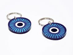 Evil eye | Two sided plexiglass keychain screenprinted & lazer cutted | 5,2 x 5,2 x 0.8 cm