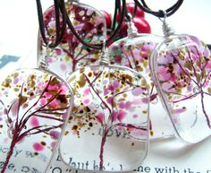 LOVE these.....Fused glass cherry blossom pendants...tree of life.