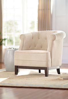 Cute and comfy is our Emma Tufted Chair. Its sweet barrel chair-style silhouette makes it a perfect small space solution. A button-tufted back offers extra style. The upholstery is plush, soft and textured. Shop at Home Decorators Collection.