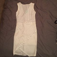 Rhapsodielle white & black dot dress Brand new, never been worn with tags. White slip cover under dress in waist and leg area Rhapsodielle Dresses Mini