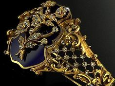 KARL FABERGE.  Lovetly detail of a chiseled gold bracelet with enamel and diamonds. c. 1900.