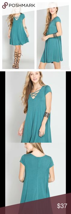 PRETTY DUSTY JADE CRISSCROSS SWING DRESS Pretty Dusty Jade Crisscross Tunic Dress Such a Gorgeous Color for Spring  Short Sleeve Stone Washed Swing Hem Line  Sizes S, M, L Cotton/Rayon Knit  Also available in Dusty Mauve  NO TRADES Peach Couture Dresses