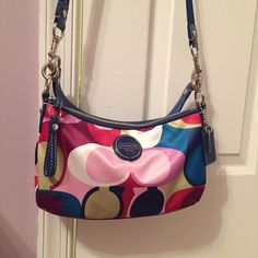 Coach Authentic Signature Multicolor Purse F15187 A beautiful Authentic Coach Signature Sateen Multicolor Scarf Print Demi Purse #F15187  It has one handle and a long removable crossbody strap in blue trim. PRICE REFLECTS CONDITION I've only used it a few times so it still looks good as new. // I don't do trades. Coach Bags Crossbody Bags