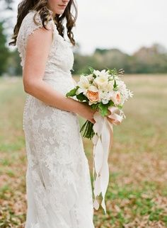 bridal bouquet with a thick short trailing ribbon