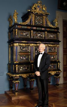 Prince Hans-Adam II von und zu Liechtenstein with one of his favorite acquisitions in the family collection, the Badminton Cabinet with delicate pietra dura in semi-precious stone and gilt bronze sculptures. Prince Hans, Cabinet Of Curiosities, Head Of State, Miniature Crafts, 10 Picture, Antique Clocks, Badminton, Furniture Styles, Antique Furniture
