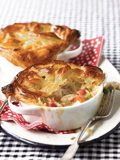 The thought of making chicken potpie for a crowd may sound like your basic nightmare (who wants to roll out that much dough—or has that many ramekins?). Not if you follow this recipe, though. Crystal Cook and Sandy Pollock, aka the Casserole Queens, tell you to buy rotisserie chicken, mix it with a few basics, cover it with frozen puff pastry dough, throw the whole thing into a 9-by-13-inch baking dish and heat until golden.