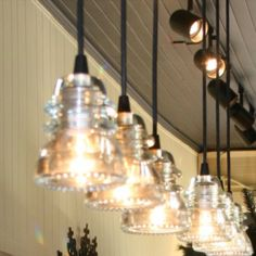 Insulator glass pendant lights at The Lemon Tree, Wake Forest NC, $200/set -- great little shop! www.thelemontreewf.com