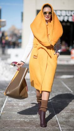 Reinvent the hoodie: Strut down the street in a bright orange oversize hoodie coat, paired with brown socks, high heel ankle boots and maxi brown handbag. Pair with round sunnies for maximum effect.