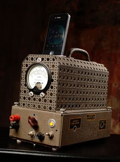 ipod iphone charging station with speakers from vintage volt meter
