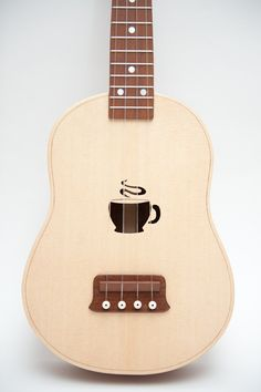 Ukulele (customizable sound hole of choice) Example: coffee cup. $450.00, via Etsy.