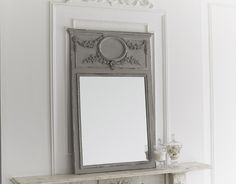 Inspired by a French Trumeau style overmantel mirror, its decorative and hand distressed grey patina finish, gives an impressive antique effect. Mirror Surface (cm): 67w x 82h Price £395.00