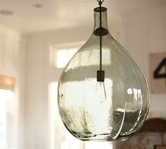 This is REALLY beautiful in person. Dining table light Clift Oversized Glass Pendant | Pottery Barn $399